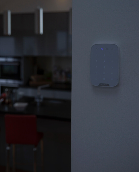 house alarm keypad at night
