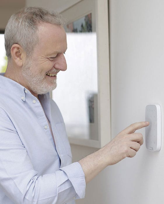 man at homesecure alarm system
