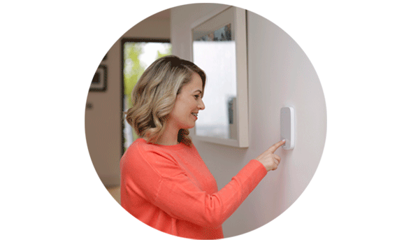 woman at house alarm system